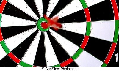 Dart landing a bulls eye in slow motion