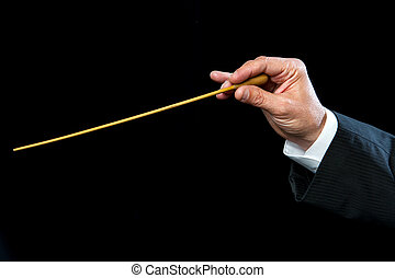 Conductors hand with baton. - Close up of male conductors...