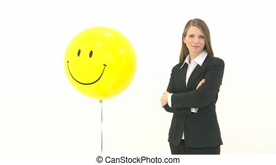 Woman with smiley Balloon - Woman standing next to smiley...