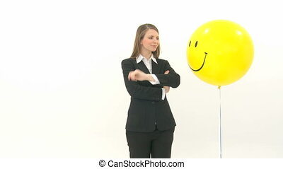 Woman standing between two balloons