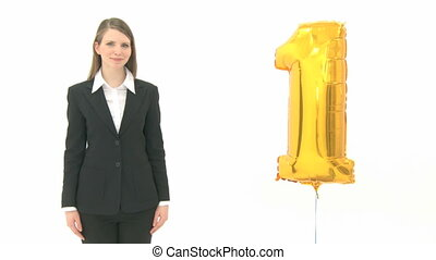 Woman presenting the golden number one