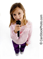 girl singing into microphone on an isolated background