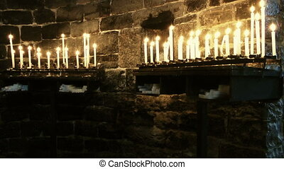 Candles in Church of Saint Peter - Burning candles in Church...