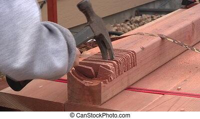 Boy chiseling off wood