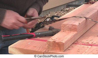 Man chiseling wood