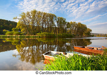 Boats on the river - Two fishing punts on the Berounka river
