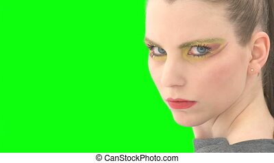 Woman in front of greenscreen with alpha-channel
