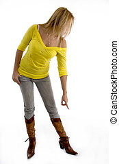 female pointing at her shoes against white background