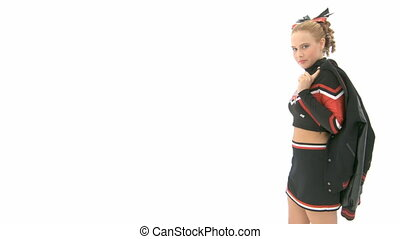 Cheerleader throws jacket over her shoulder and leaves the...