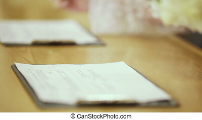 Bride and Groom Signing Marriage contract - The bride and...