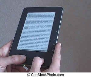 man's hand switches pages e-book