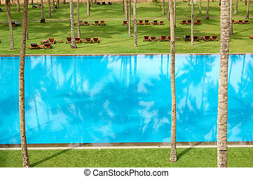 The swimming pool and green lawn at luxury hotel, Bentota,...