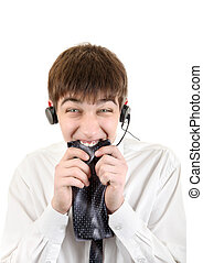 Nervous Young Man in Headphones bite his Necktie Isolated on...