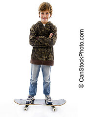 front view of smiling boy standing on skateboard