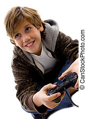 side view of amused boy playing videogame - side view of...