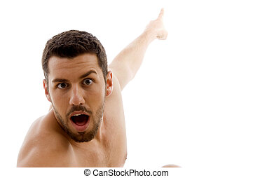 front view of surprised man pointing with white background