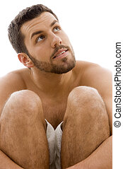 front view of man in towel looking sideways front view of...