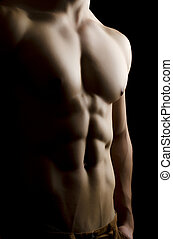 Muscular man body on black background
