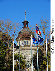 Capitol and Flags - Capitol is flanked by flags flying,...