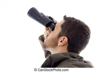 side view of hispanic man looking through binoculars