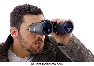 side view of man looking through binoculars on an isolated...