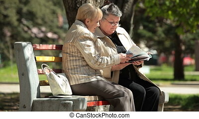 Senior Women Reading Magazines - Senior women friends...