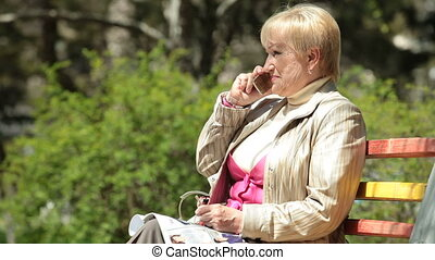Smiling Senior Woman On The Phone - Smiling senior woman...