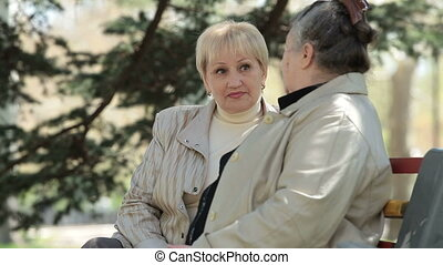 Senior Female Friends - Cheerful senior woman speaks with...