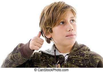 front view of boy with thumbs up on an isolated white...