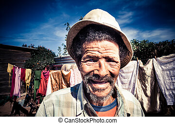 happy old man - senior african man smiling brightly wearing...