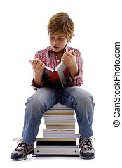 front view of boy sitting on books with white background