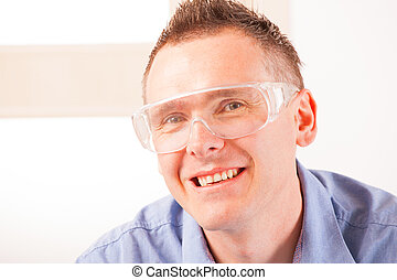 Safety glasses - Man wearing protective safety glasses