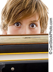eyelevel view of boy with books