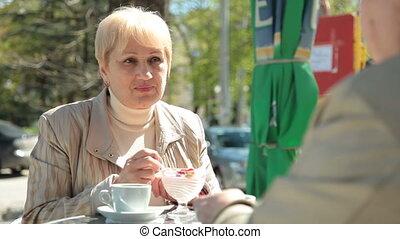 Enjoying Dessert At Outdoor Cafe - Senior Women Enjoying...