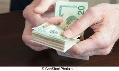 Male Hands Counting Money