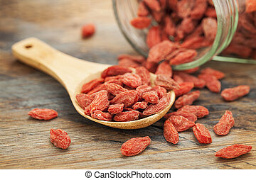 Tibetan goji berries wolfberry spilling of the glass jar on...