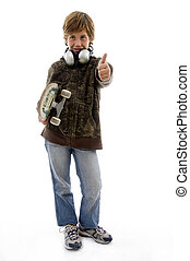 front view of boy holding skateboard and showing thumbs up