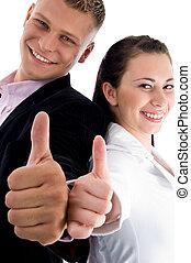pleased couple wishing goodluck