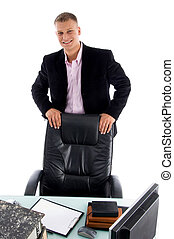 smiling businessman in workplace