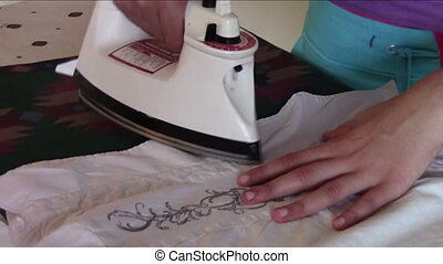 Ironing - Close up of blouse being ironed