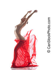 Young topless woman dancing with cloth in studio, isolated...
