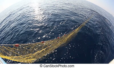 Fishing Cutter - Fishing net thrown into the sea