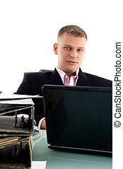 businessman with laptop and files in an office
