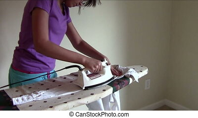 Ironing Sleeve - Young woman ironing blouse sleeve