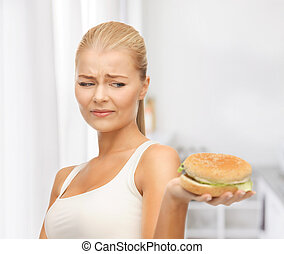 woman rejecting junk food - picture of healthy woman...