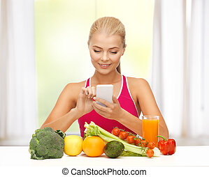 woman with fruits, vegetables and smartphone - woman with...