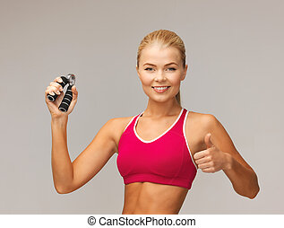 woman with hand expander - beautiful sporty woman with hand...