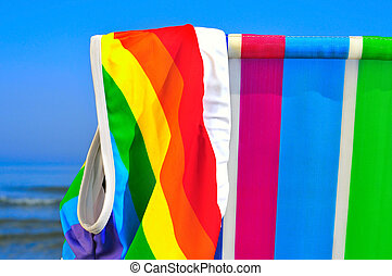 gay beach - a swimsuit patterned with the rainbow flag on a...