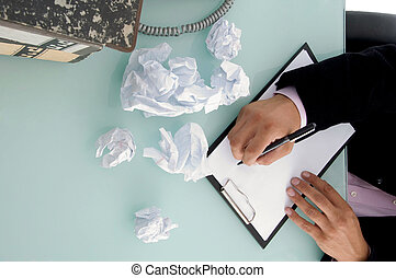 man trying to write something in an office