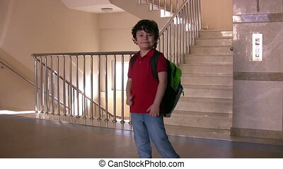 Little student walking down the stairs